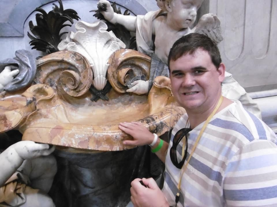 Graham touching sculptures in St. Peter Basilica