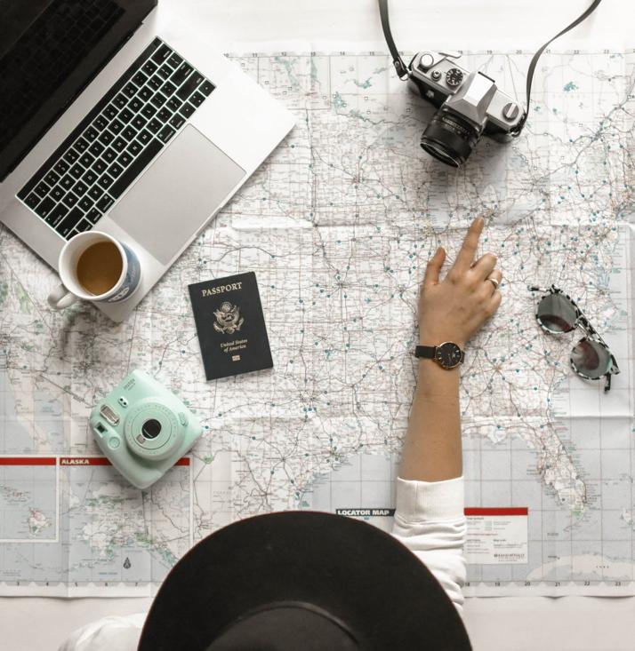 appla computer, passport and digital camera