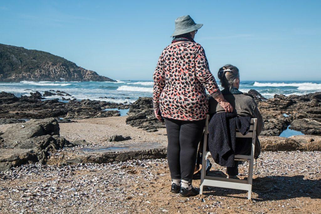 elderly women in front of the sea